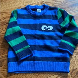 Striped monster eyes sweater